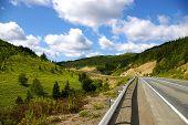 stock photo of sakhalin  - The Mountain road on island Sakhalin by summer - JPG