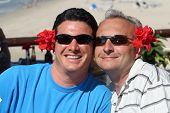 stock photo of gay couple  - happy men couple at tropical resort - JPG