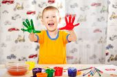picture of finger-painting  - funny boy with painted fingers - JPG