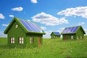 picture of solar battery  - houses from the grass with solar panels on the roof - JPG