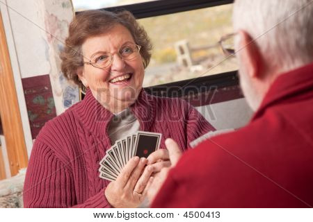 Happy Senior Adult Couple Playing Cards