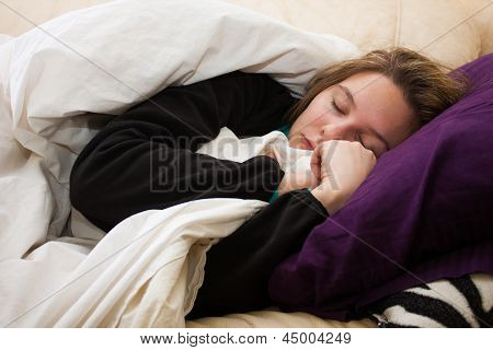 Sick Young Woman Sleeps On Couch