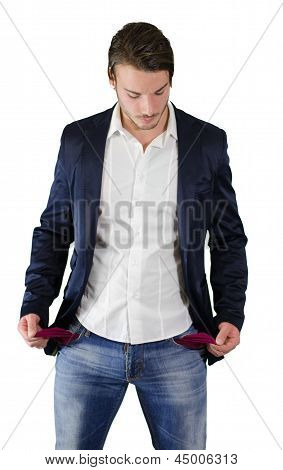 Broke Young Man Looking At Empty Pockets