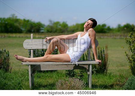 Brunette sat on park bench