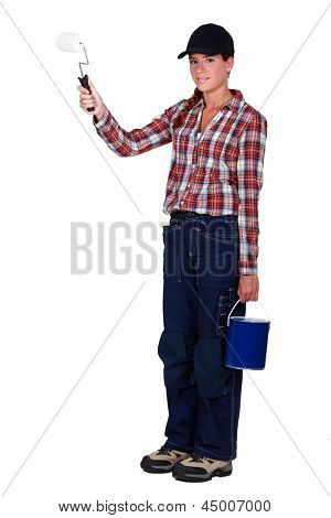 craftswoman painter holding a brush and a can