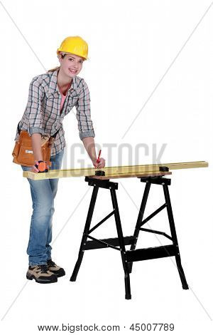 craftswoman measuring a board
