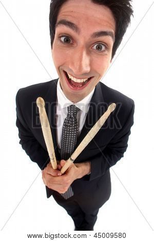 Businessman holding drum sticks