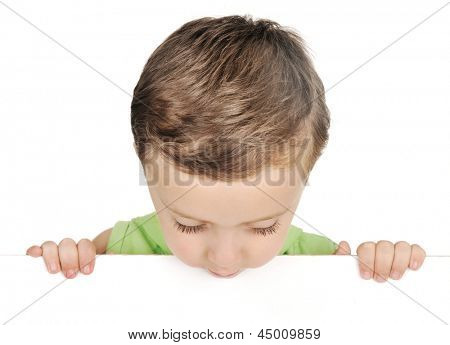 Young boy looking down over white blank sign