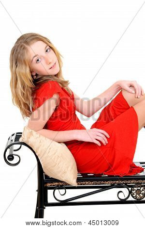 child with red dress on bench