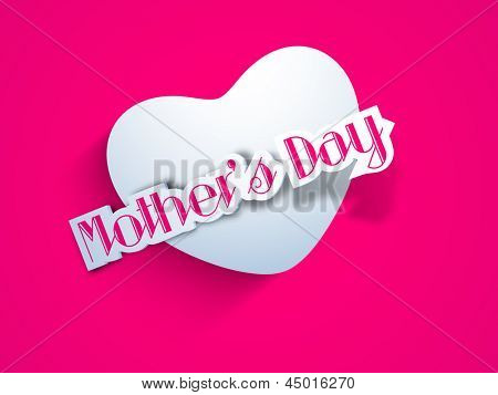 White paper heart with text mothers day on pink background.