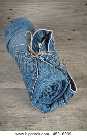 Rolled Jeans Arranged In A Pyramid