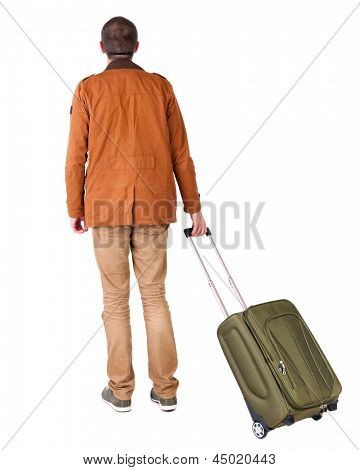 Back view stylishly dressed man in  brown jackett with green suitcase looking up. Standing young guy in jeans. Rear view people collection.  backside view of person.  Isolated over white background.