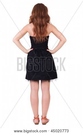 back view of standing young beautiful  woman With long red curly hair. girl  watching. Rear view people collection.  backside view of person.  Isolated over white background.