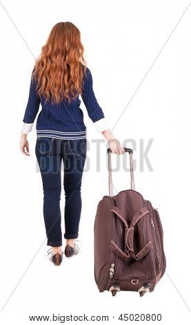 back view walking  woman  with suitcase. beautiful redhead girl in motion.  backside view of person.  Rear view people collection. Isolated over white background. Woman office worker rolls a brown bag
