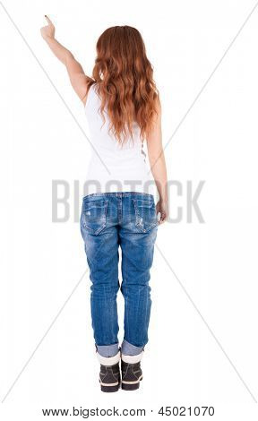 Back view pointing woman. beautiful redhaired girl. girl shows something. Rear view people collection. backside view person. Isolated over white. Girl in T-shirt points a finger at something