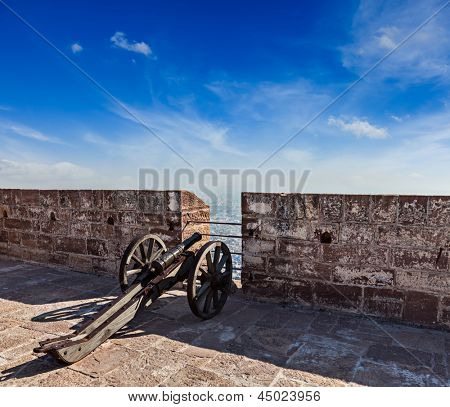 Old canon in Mehrangarh Fort overlooking city, Jodhpur, Rajasthan, India
