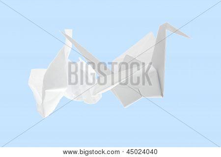 Origami Crane And Crumpled Paper.