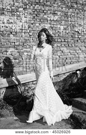Beautifull Woman In White Dress Posing Outdoor