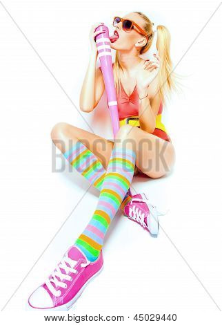 Sexy Baseball Girl Wearing Colorfull Clothes Posing With A Baseball Bat