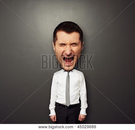 photo of bighead screaming man over dark background