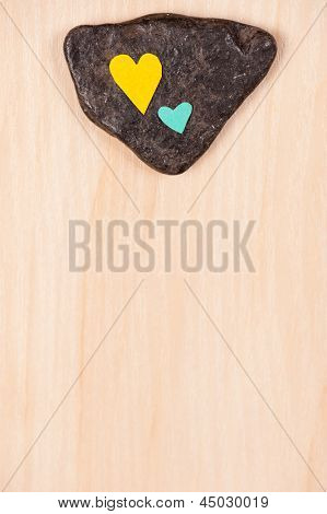 hearts on stone and wooden background