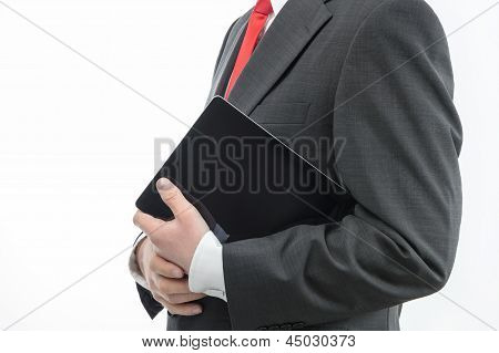 Businessman Carrying Digital Tablet
