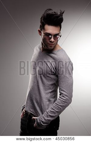 Sexy Fashion Man Model Dressed Casual Posing Dramatic In The Studio - Low Key