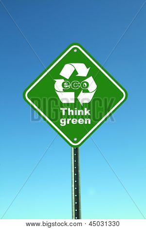 Eco think green road sign against blue sky