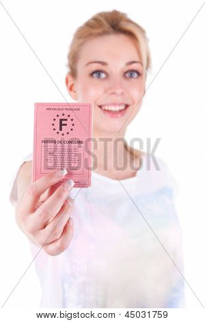 Happy Caucasian Teenage Girl Showing Her Driving License - Caucasian People