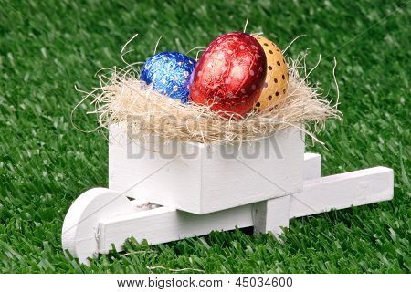 Photo of Colored Easter Eggs and Pushcart
