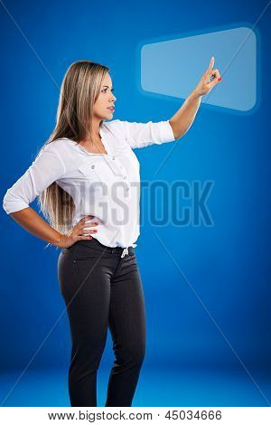 Technology concept: Casual business woman touching digital screen