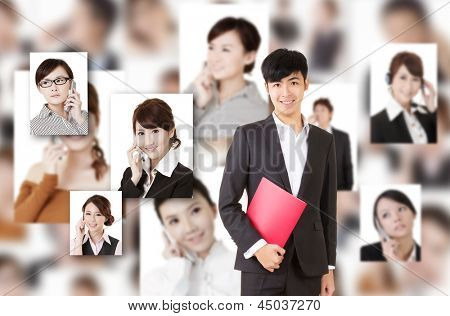 Young businessman of Asian stand in front of business portrait wall.