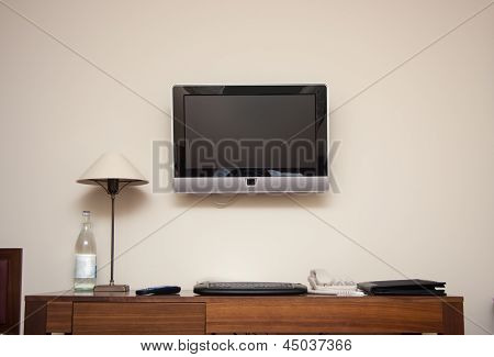Study Room With Writing Desk Keyboard Phone Lamp And Lcd Tv Set