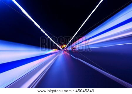 car fast in tunnel with blur light