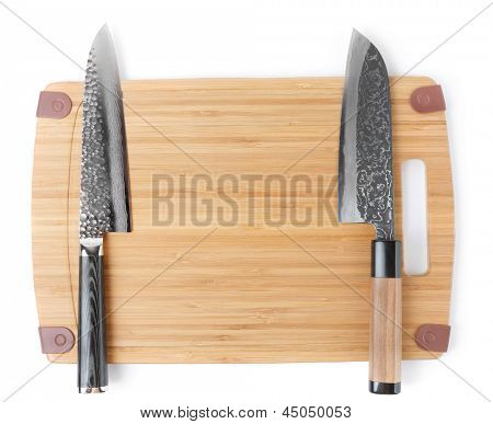 Two expensive japanese knives on cutting board, isolated