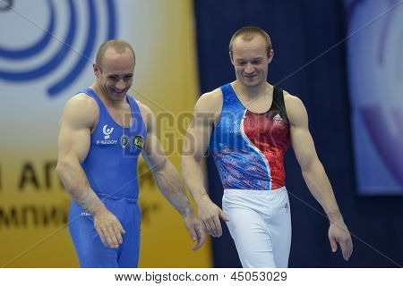 MOSCOW, RUSSIA - APRIL 21: Pinheiro-Rodrigues, France, right, and Morandi, Italy  win bronze medals on 5th European Championships in Artistic Gymnastics in Moscow, Russia on April 21, 2013