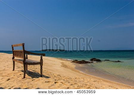 Chair On Beach With Blue Sea