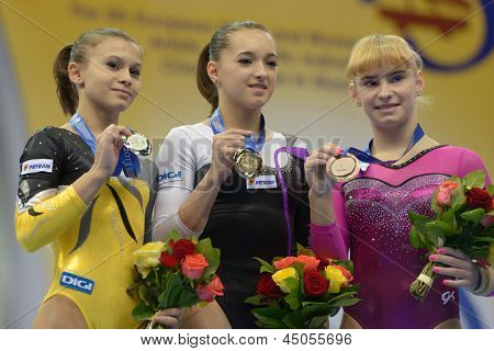 MOSCOW, RUSSIA - APRIL 21: Bulimar (left), Iordache, both - Romania, Grishina, Russia (right) with medals during 5th European Championships in Artistic Gymnastics in Moscow, Russia on April 21, 2013
