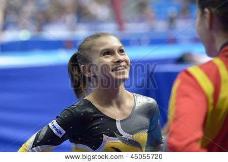 MOSCOW, RUSSIA - APRIL 21: Diana Laura Bulimar, Romania wait results of exercise on balance beam in final of 5th European Championships in Artistic Gymnastics in Moscow, Russia on April 21, 2013