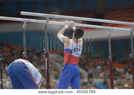 MOSCOW, RUSSIA - APRIL 21: Emin Garibov, Russia prepares the apparatus for exercise on parallel bars in final of 5th European Championships in Artistic Gymnastics in Moscow, Russia on April 21, 2013