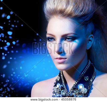 Fashion Rocker Style Model Girl Portrait. Hairstyle. Rocker or Punk Woman Makeup and Hairdo
