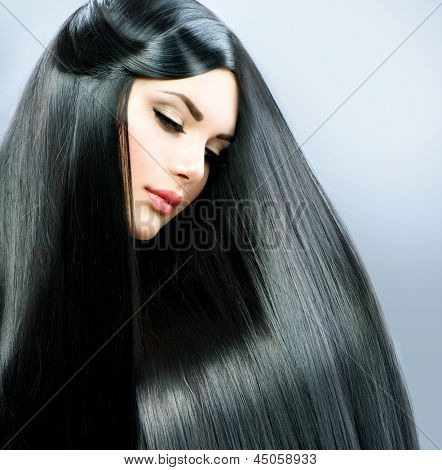 Long Straight Hair. Beautiful Brunette Girl. Healthy Black Hair. Beauty Model Woman. Hairstyle