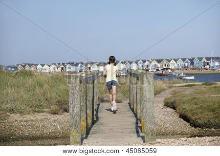 Young Girl On Foot Bridge