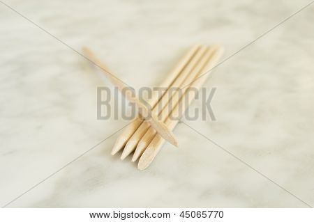 Cuticle pushers on marble orange wooden sticks