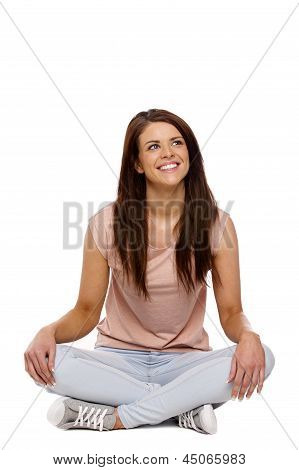 Brunette Woman Sat Cross Legged On White