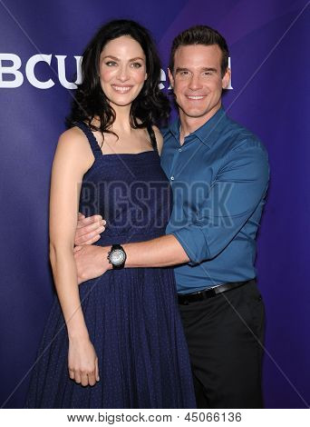 LOS ANGELES - APR 22:  Joanne Kelly & Eddie McClintock arrives to the NBC Universal Summer Press Day 2013  on April 22, 2013 in Pasadena, CA.