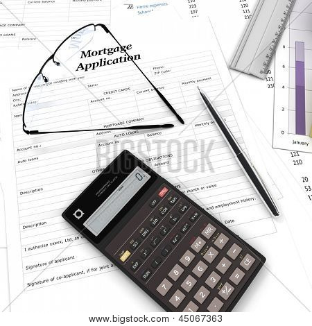 A mortgage application form, some graphics a calculator and reading glasses, suggesting home buying decision