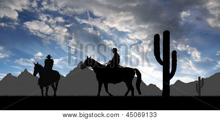 Silhouette cowboys with horses in the sunset