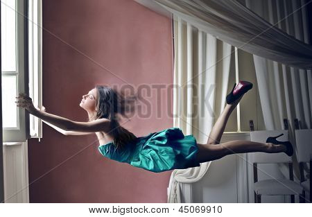 beautiful woman fly opening the window