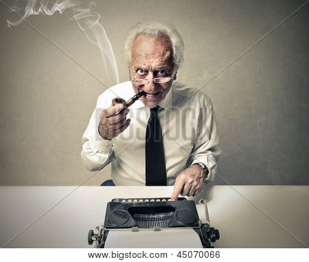 senior journalist writing with a typewriter